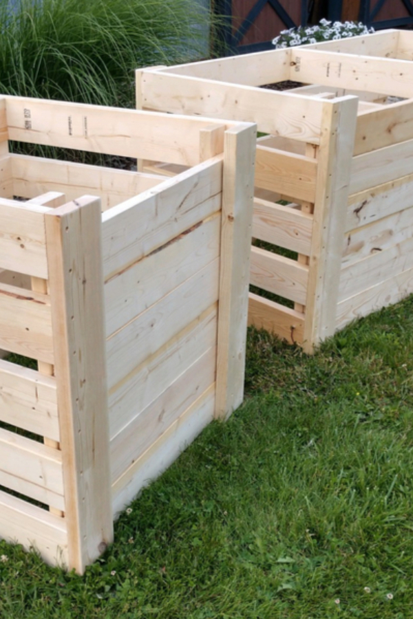 Two beautiful DIY wooden compost bins next to one another allow you to compost like a pro.